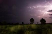 Horizontal lightning lights up the Cambodian night sky.