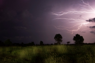 Horizontal lightning lights up the Cambodian night sky.