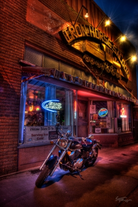 A motorcycle in front of Iron Horse Saloon, central Idaho.