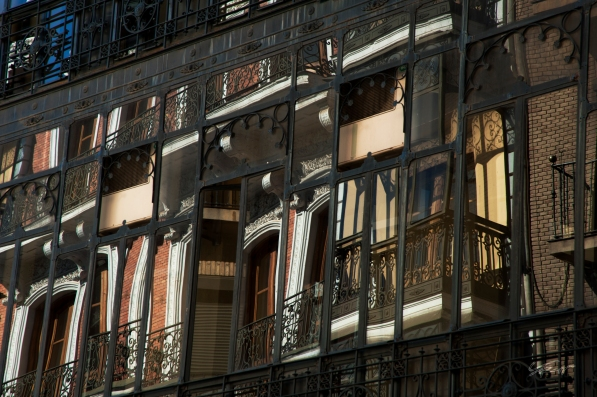 View of apartment windows from the streets of Madrid, Spain.