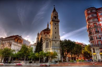 The beautiful architecture of Iglesia de San Manuel y San Benito as seen from Parque del Retiro, Madrid, Spain.