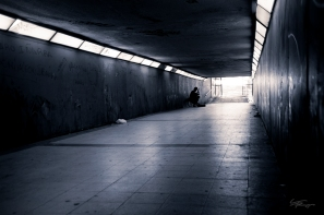 A lone musician plays in the underpass that Calle de Alcala with Parque del Retiro, Madrid, Spain.
