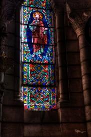 Stained glass illuminates catacombs, Madrid, Spain.